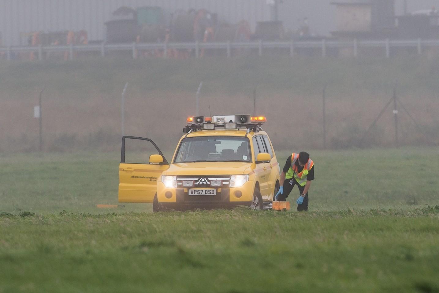 Engineers assessing the runway