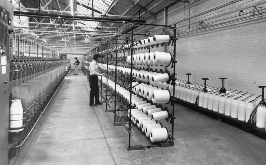 The 19th century works in 1977. A Richards Ltd. worker is supervising the production of twisted filament nylon for carpets