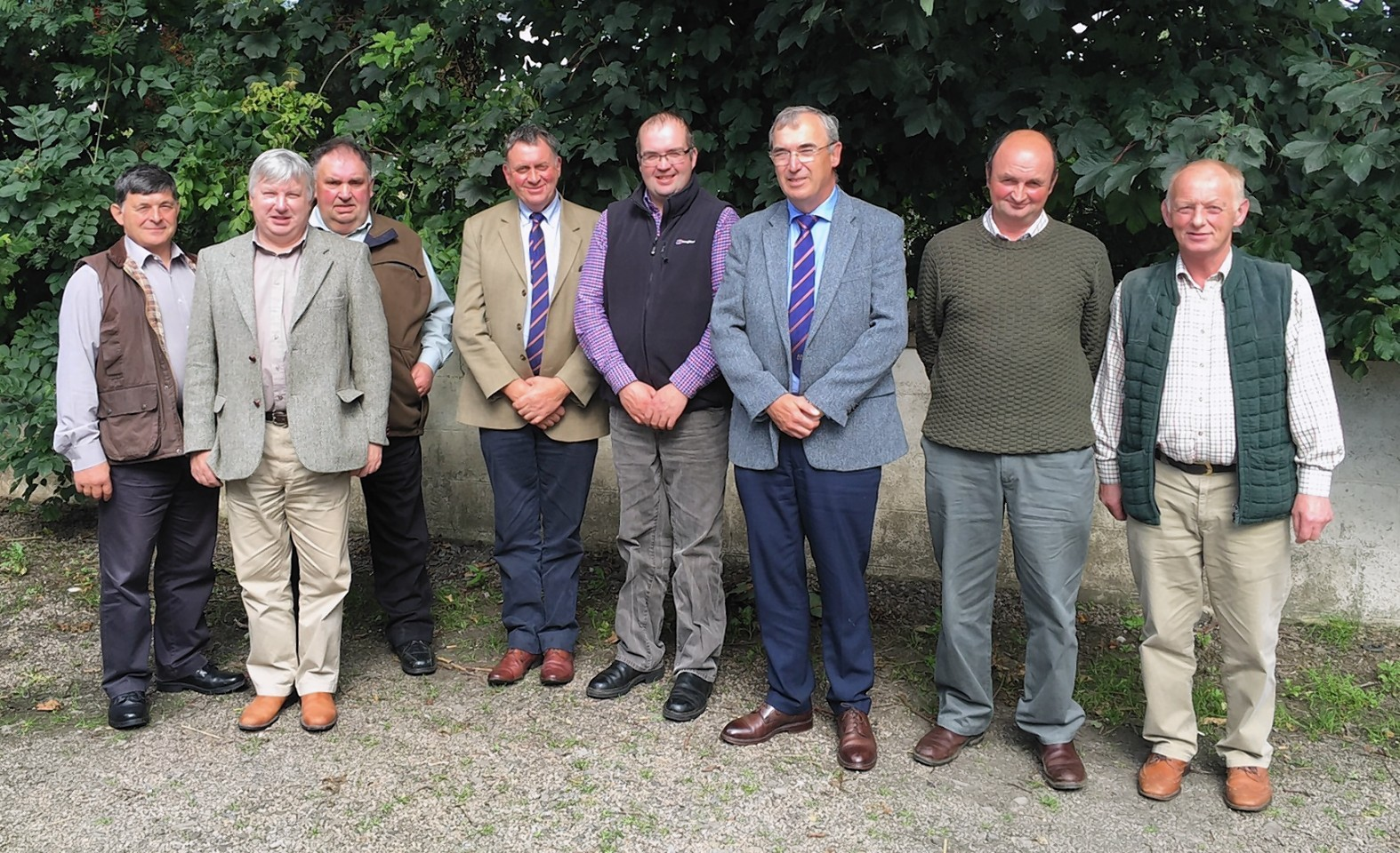 Arnott Coghill, Rodney Brass, Billy Campbell, Pete Watson (ANM Group's vice chairman), Stephen Sutherland, Pat Machray (ANM Group's chairman), Ian Gunn, and Donald Hymers. Andrew Mackay is not in the photograph.