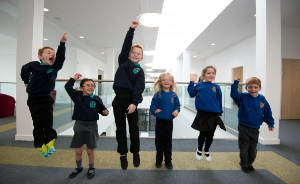 Pupils jump for joy in their new school