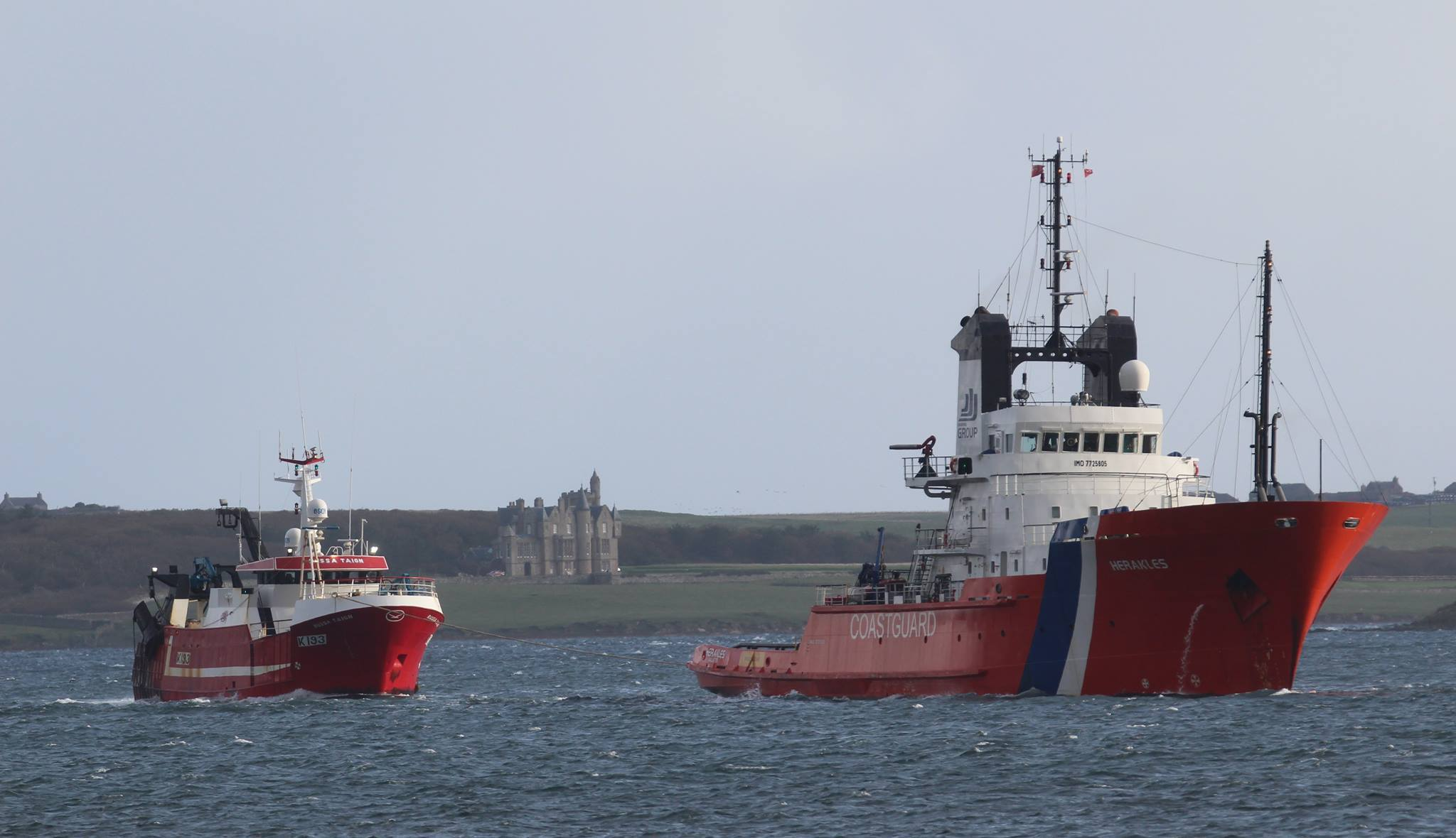 ETV Herakles towing the stricken vessel into Hatston