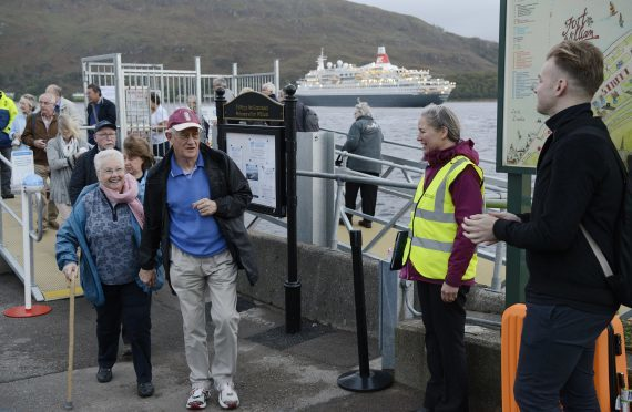 Boudicca passengers disembark to a warm welcome  from Sarah Kennedy of the Fort William Marina and Shoreline Company and other volunteers