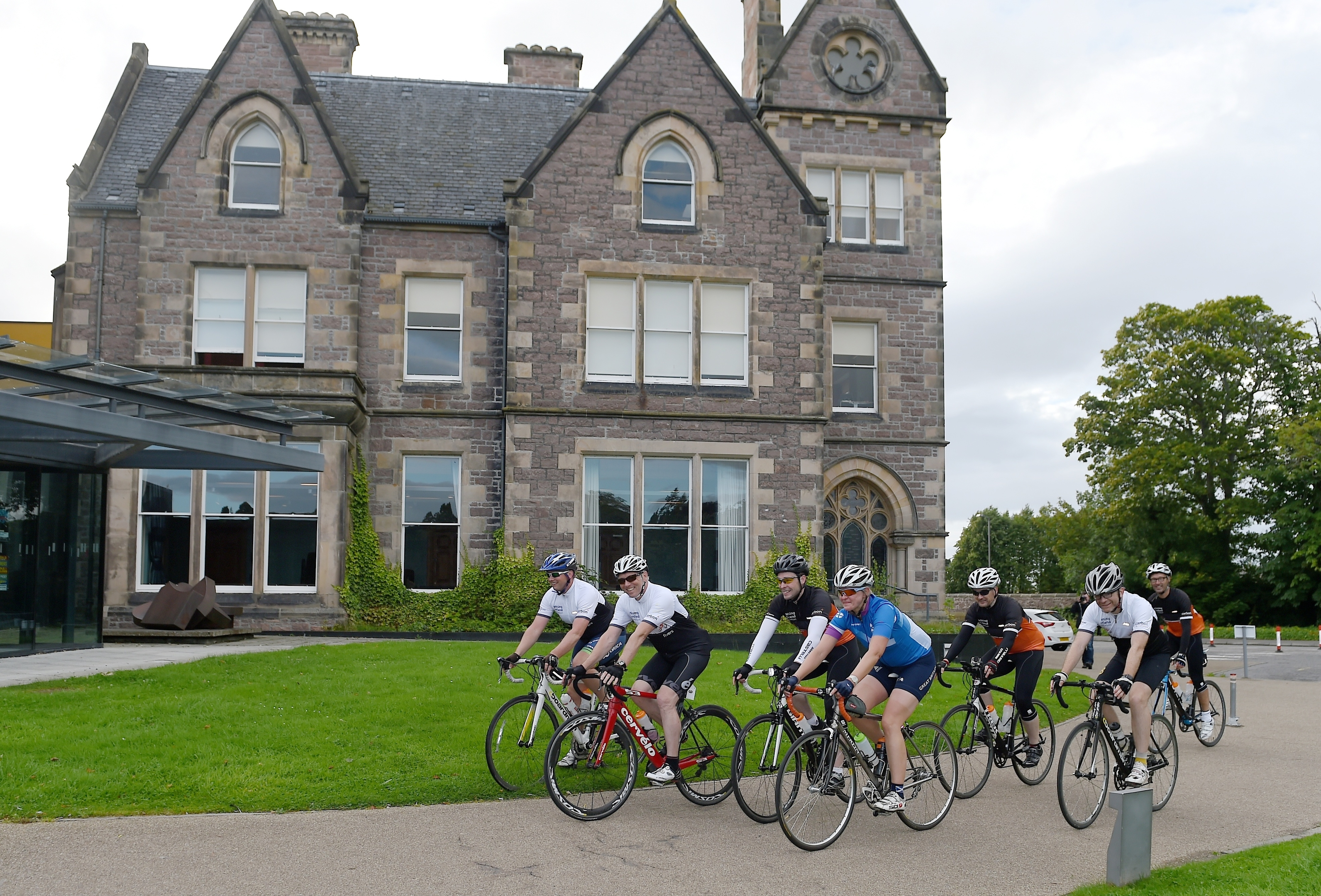 The cyclists arrive outside Eden Court Theatre in Inverness at the end of their 500 mile trip.
