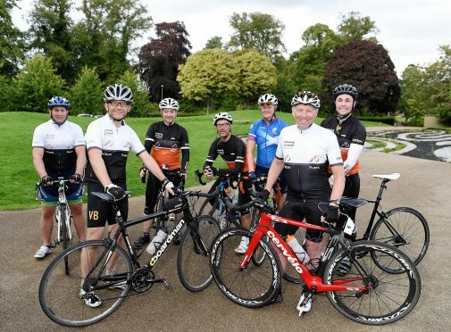 Winning Scotland charity cycle ride round the north of Scotland.    (L-R) Max Chassels, Nigel Chapman, Mark Christie, Richard Wadsworth, Fiona Duncan, Ian Ord and Iain Harper after completing their route.