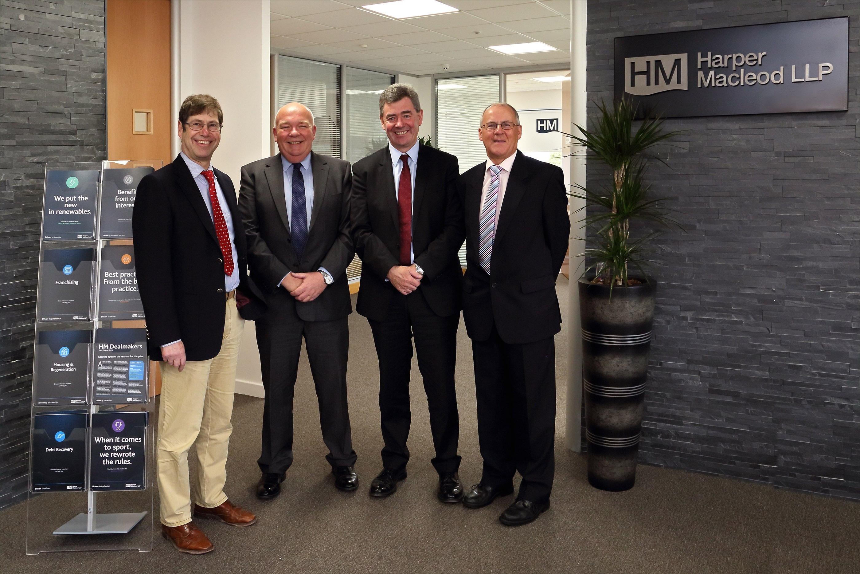 Left to right, David Allen, Gary Campbell, Professor Lorne Crerar, and Donald Shaw at Harper Macleod's Inverness offices.