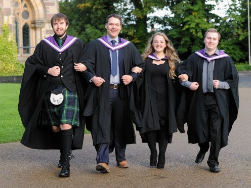Inverness College UHI Graduations in Eden Court.  Friends united, Mark Paulin of Inverness, Michael Van't Zand of Kiltarlity, Holly Fraser of Inverness  and Adam Wylie of South Ronaldsay,