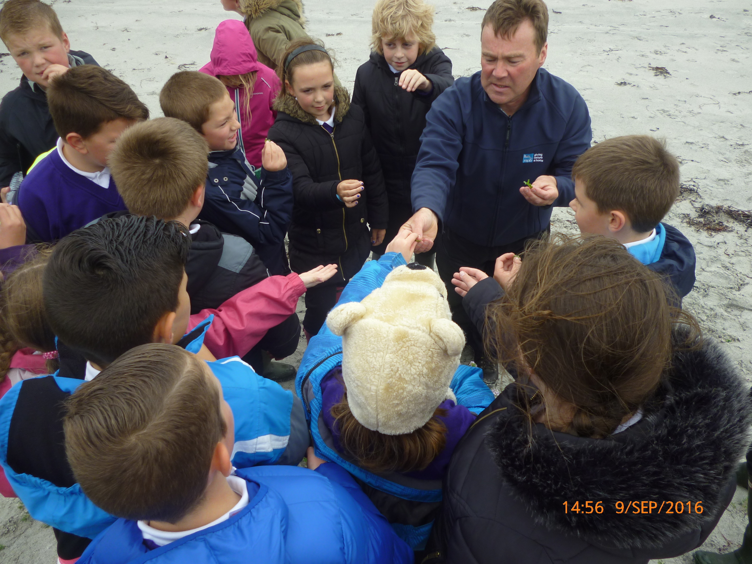 RSPB Scotland's site manager for Balranald Jamie Boyle with the children
