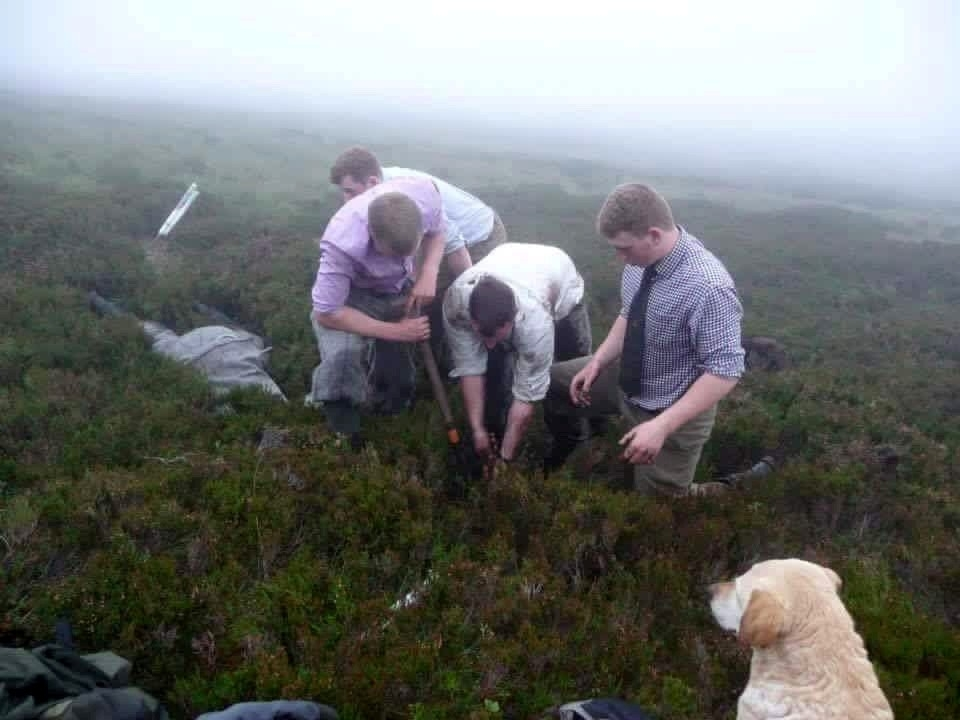Team Invermark digging out Jazz. See Centre Press story CPHOLE; These dramatic pictures show a brave gamekeeper climbing head first into an underground pipe to rescue a dog who went missing on an Angus moor. Cocker spaniel Jazz disappeared while picking up game during a grouse shoot at the Invermark Estate on Tuesday. She was eventually found down a muddy open pipe on the moor. Gamekeepers dug through 6ft of wet peat to retrieve her Jonny Stevenson pushed himself down the pipe to check on the spaniel's condition.