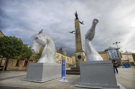 gratis editorial photo.. Scale models of The Kelpies, the world's largest pair of equine sculptures, have arrived in Inverness ahead of the World Canals Conference, which is set to welcome more than 300 global delegates to the city. The 1/10th scale maquettes will stand in the Highland Capital's Falcon Square from Monday 12th September until Sunday 25th September. The visit follows the sculptures' stay on the Caledonian Canal at Neptune's Staircase, the longest lock flight in Britain. The three-metre-tall Kelpies, which have toured the world helping to promote Scotland and the Falkirk area as a visitor destination, have previously appeared at major events including New York's Scotland Week, the Grand National and the Ryder Cup. more info from Chris McDonald, Scottish Canals,  07917217608 or email Chris.McDonald@scottishcanals.co.uk