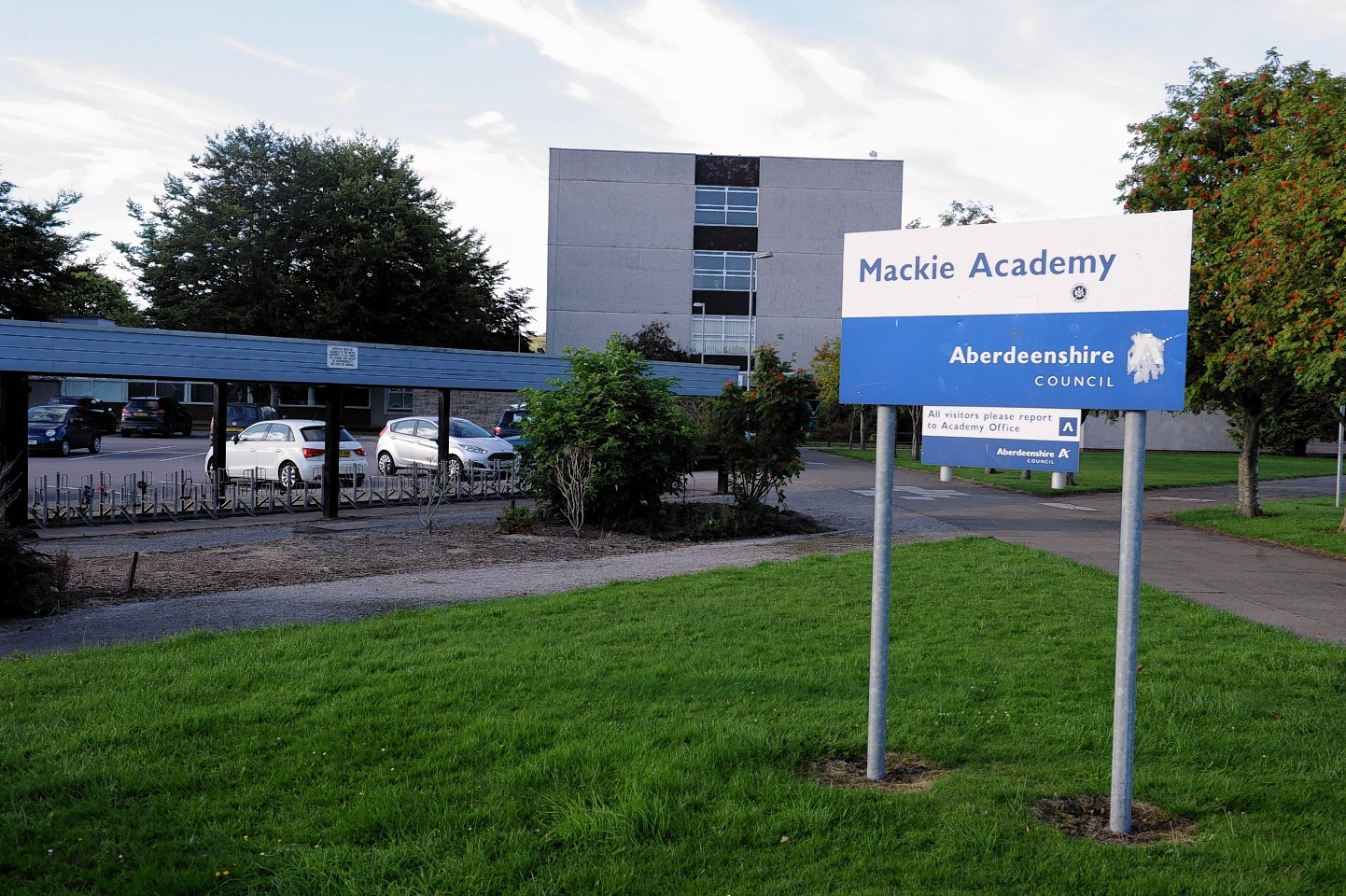 Mackie Academy. Social distancing guidance meant pupils were forced to stand outside in a storm on Tuesday.