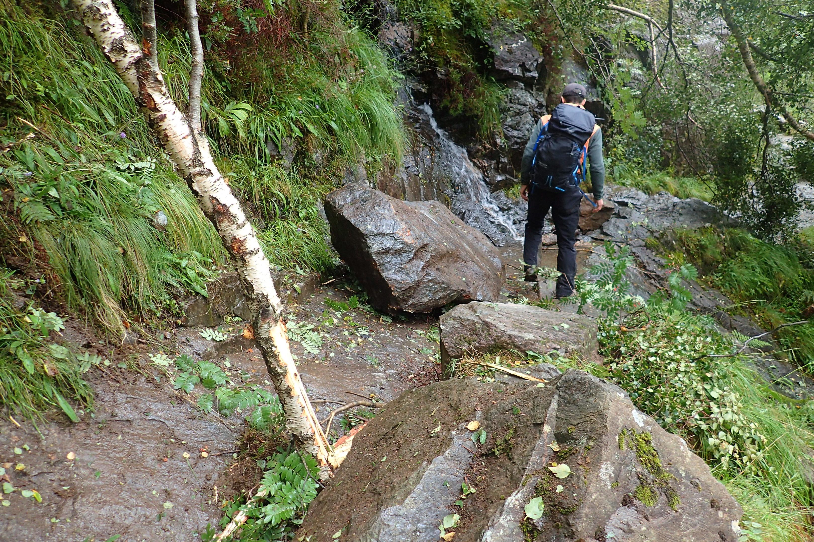Large rocks blocking the Steall Gorge footpath after the landslide