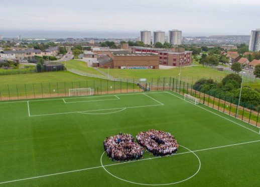 Pupils and staff formed a giant 60 in the school's playing fields.