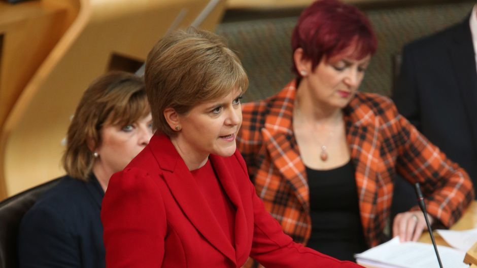 First Minister Nicola Sturgeon (centre) delivers a speech outlining her legislative programme for the coming year