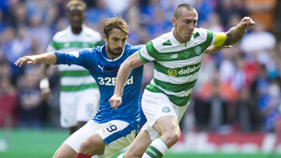 Celtic captain Scott Brown, right, came out on top against Joey Barton last time out