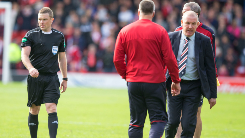 Mark Warburton, right, could not hide his frustration at match referee John Beaton, left.