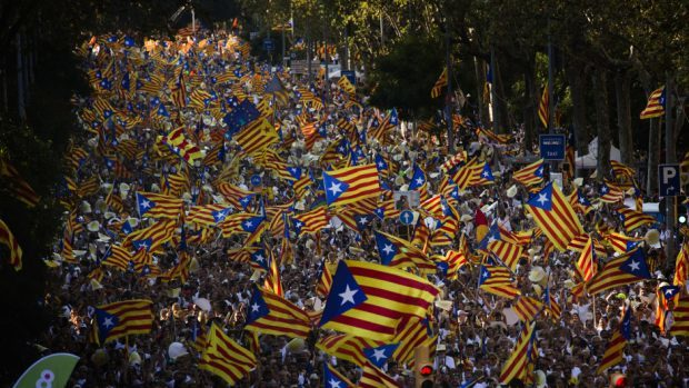 """People wave """"estelada"""" flags, that symbolise Catalonia's independence, during a demonstration in Barcelona (AP)"""