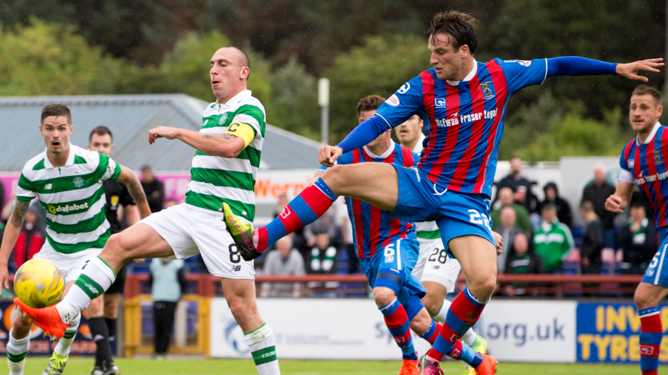 Brad McKay (right) in action against Celtic