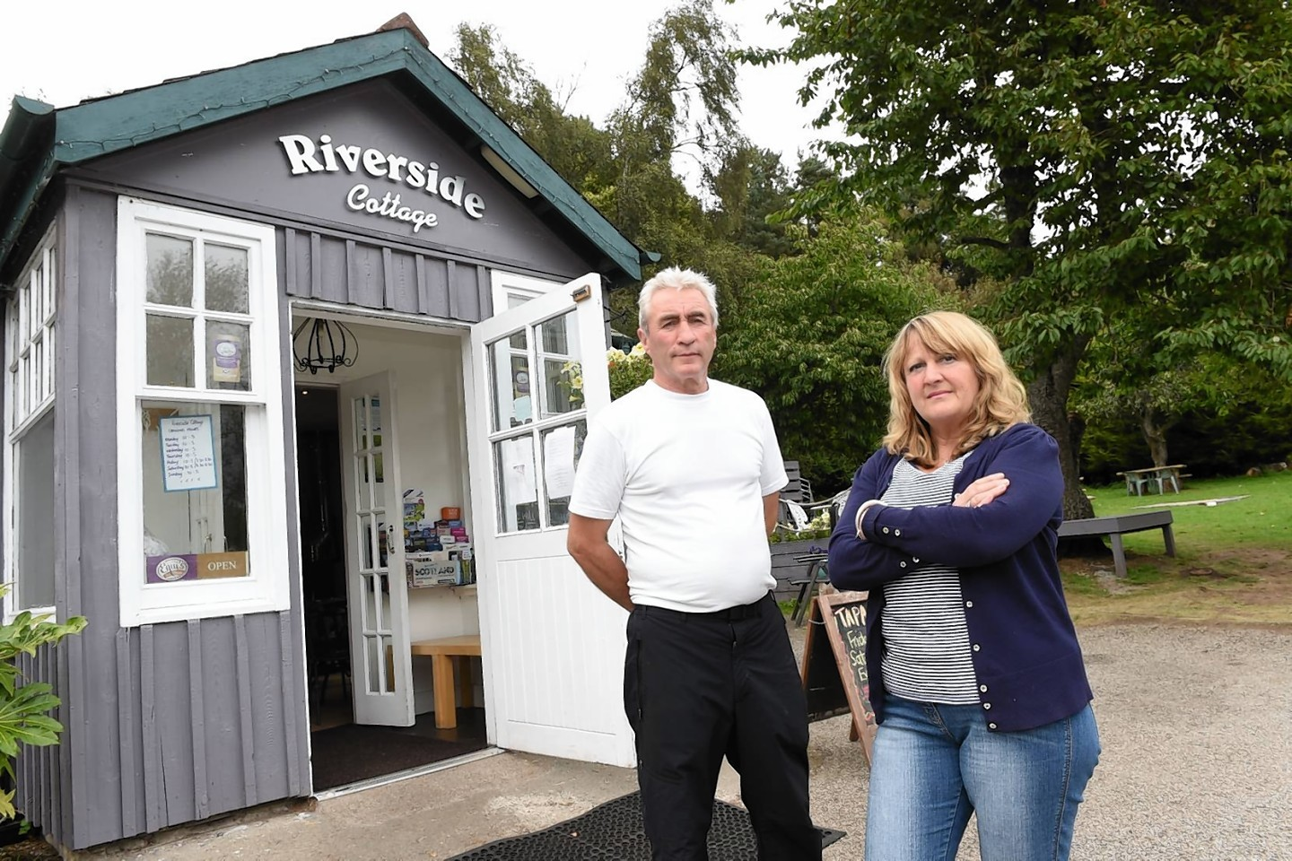 John and Wilma Doherty who are concerned about the lack of customers at their Riverside Cottage cafe due to roadworks on the A93 east of Ballater.  Picture by KEVIN EMSLIE