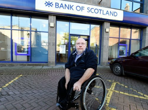 The Bank of Scotland/Halifax at John Street, Aberdeen, is closing at the end of the month with other branches not wheelchair friendly. In the picture is wheelchair user, Ron Holding at the bank.  Picture by Jim Irvine  30-9-16