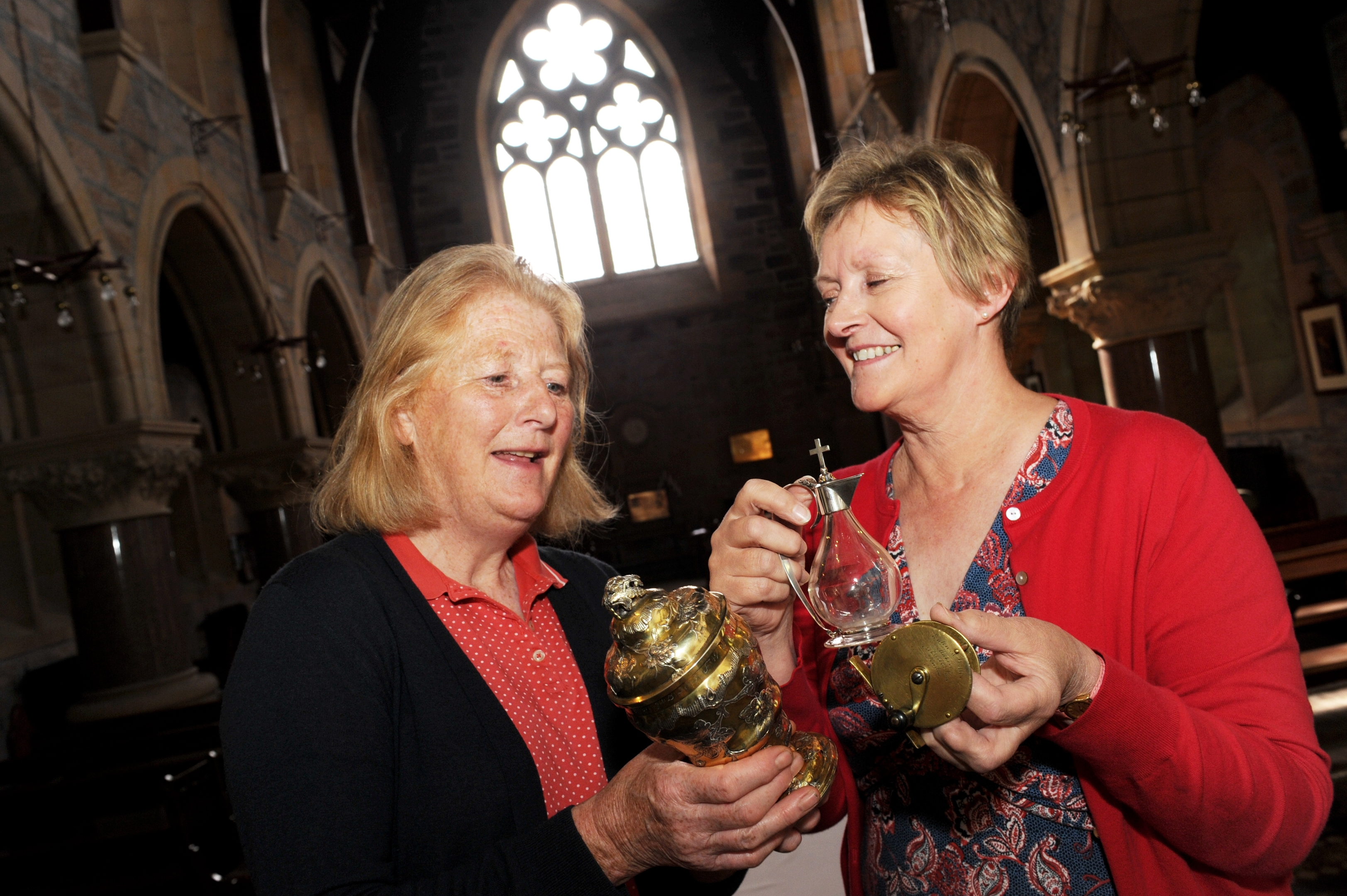 Nicola Irwin, left, and Kath Davies, right, with some of the antiques to be valued at St Margaret's Episcopal Church, Aberlour. Picture by Gordon Lennox