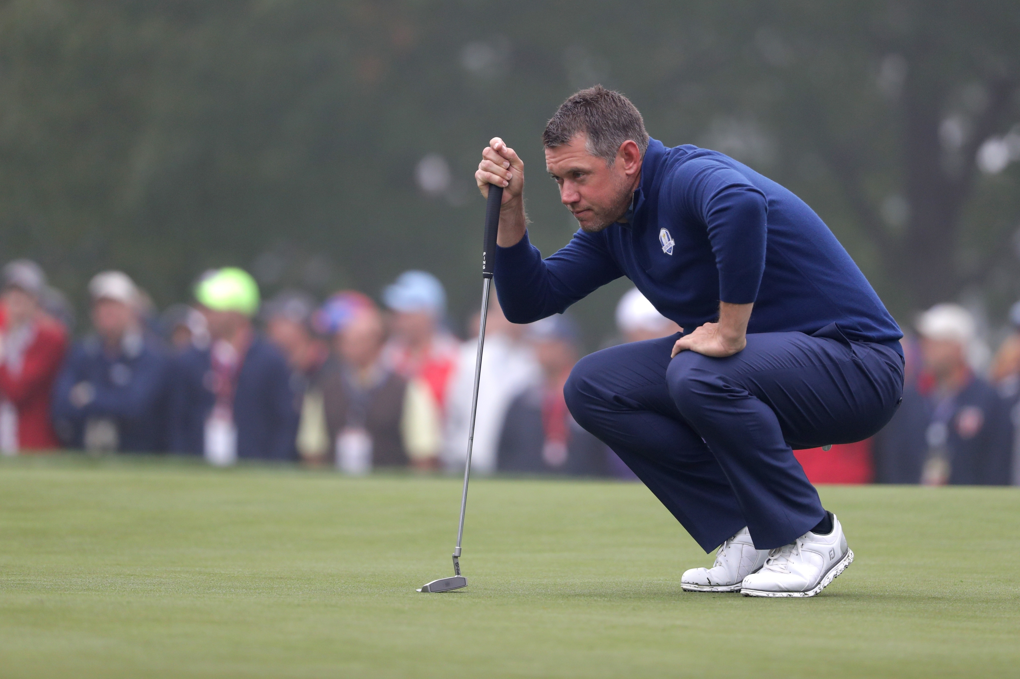 Lee Westwood of Europe lines up a putt