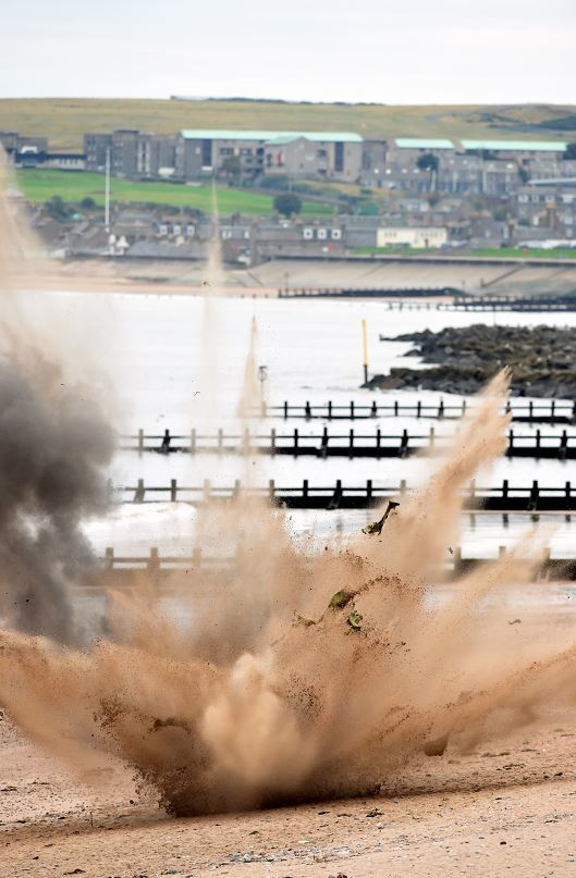 The Royal Navy's bomb squad detonates a mine washed up on Aberdeen beach. (Picture: Kami Thomson).