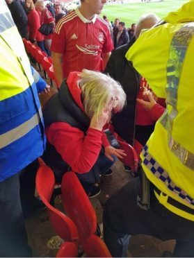 Dons fan left injured by missile thrown during Celtic clash