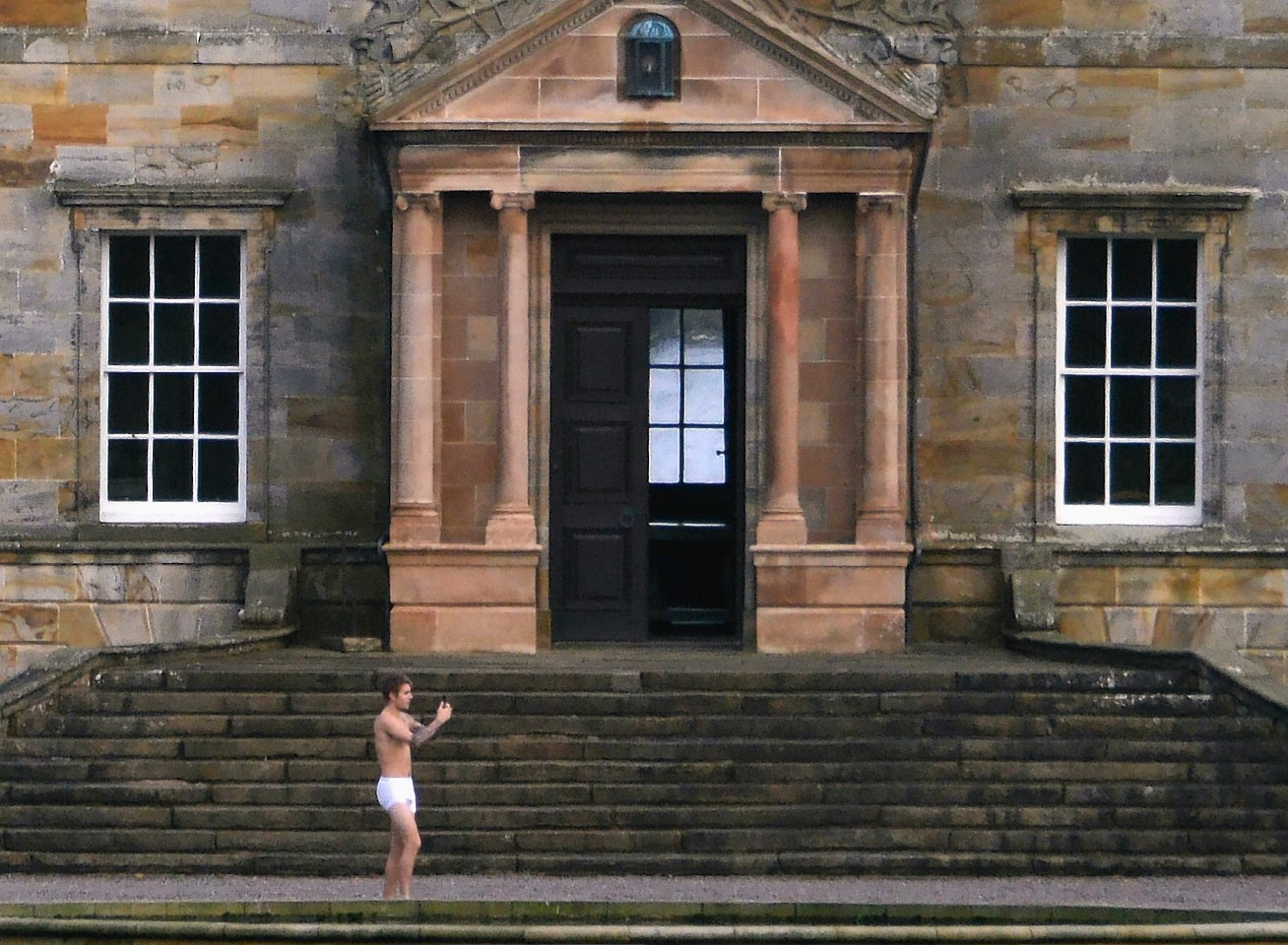 Singer Justin Bieber in his underpants outside Kinross House