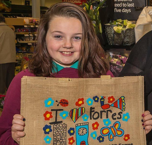 Charlotte shows off her winning bag design
