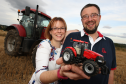 Andrew and Claire Cameron at their farm on the Black Isle. Andrew runs the Black Isle Show, where Claire is running an exhibit of model vehicles to raise money for Marie Curie. Picture: Andrew Smith