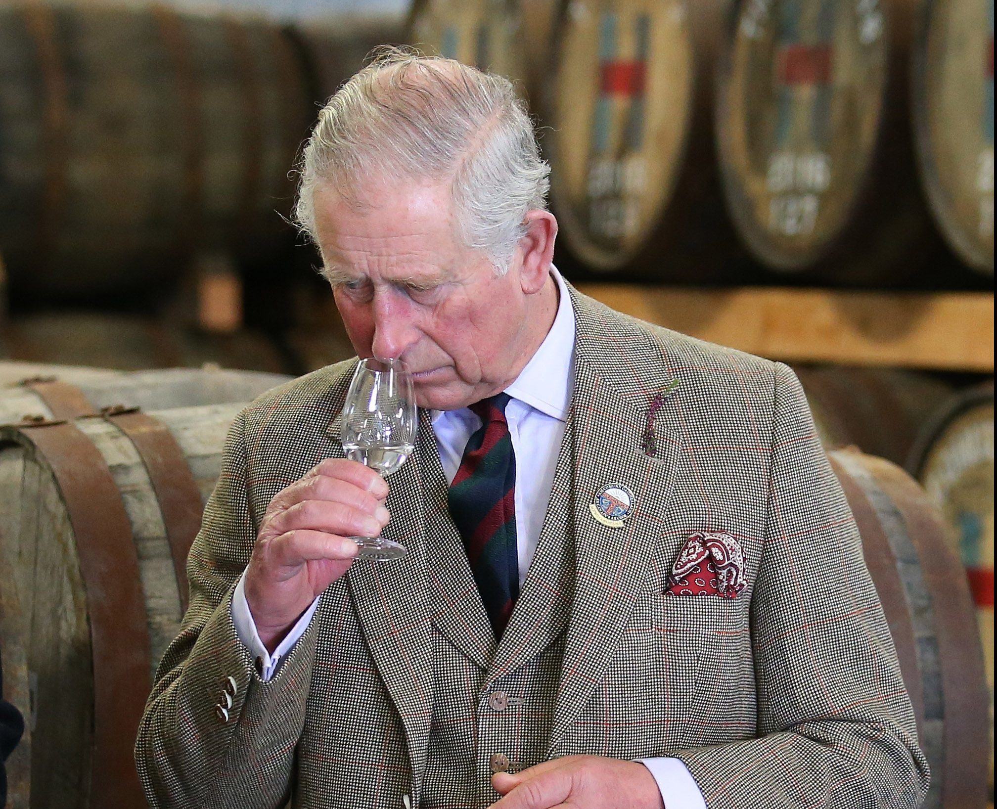 The Prince of Wales, known as the Lord of the Isles while in the Western Isles, noses a malt during a visit to the Isle of Harris Distillery