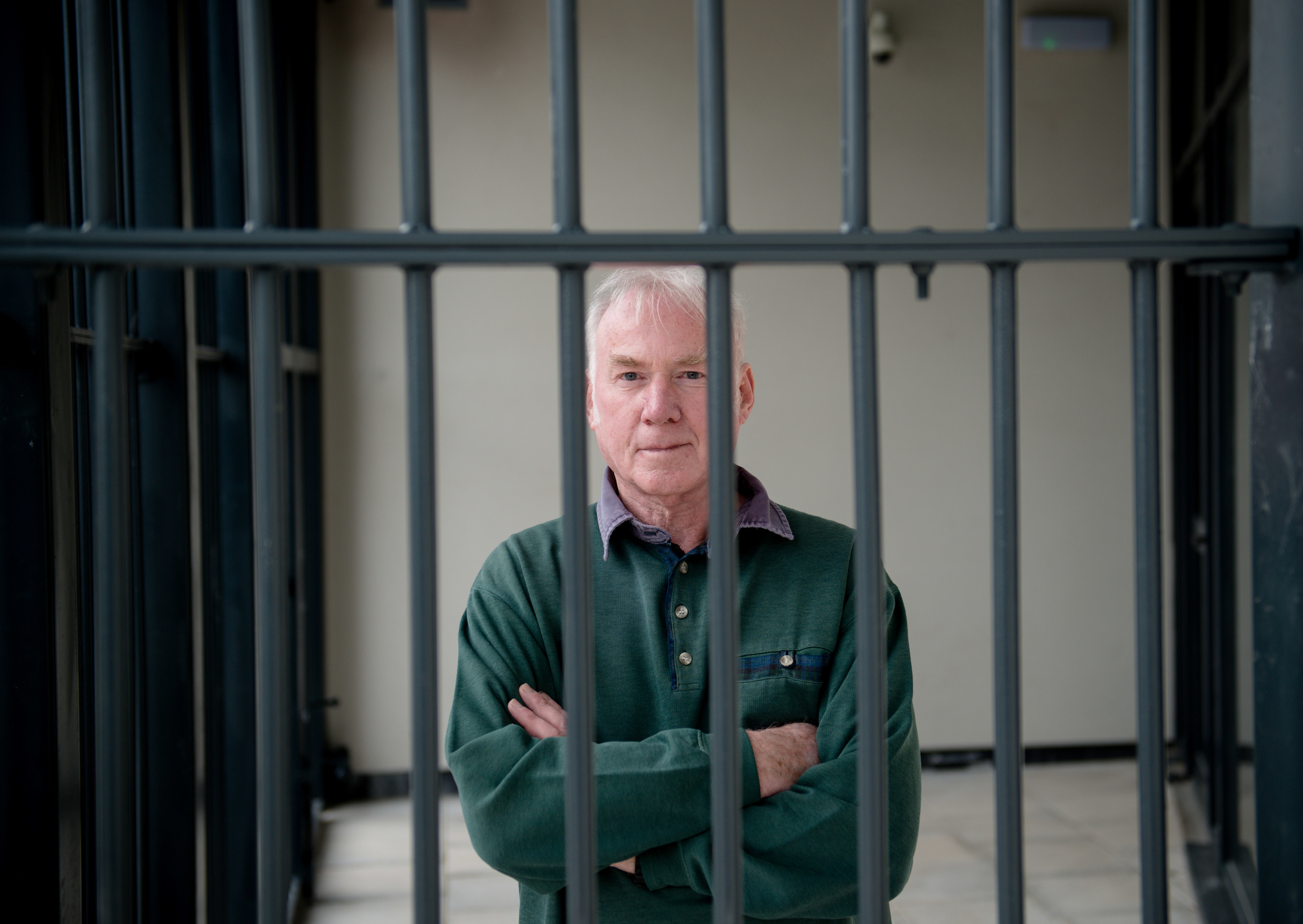Caol Regeneration Company chairman Donnie Corbett behind the bars around the library at the new school campus