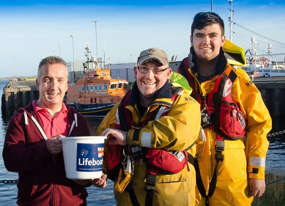 Graham Duthie hands his donation over to Victor Sutherland of Fraserburgh lifeboat station.