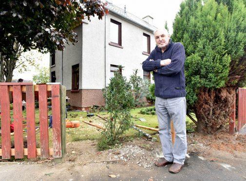 James Lawless at his garden where the van broke through the fence and entered his garden.