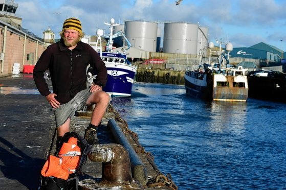Josh Hicks stops in Peterhead during his coastal walk for charity.