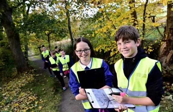 Pupils from the Lumphanan primary are out on popular walks around the village looking for areas affected by dog dirt.