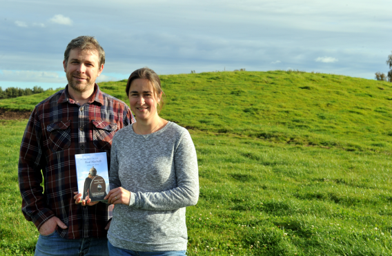 George and Karen Sutherland on Macbeth's Hillock near Brodie.