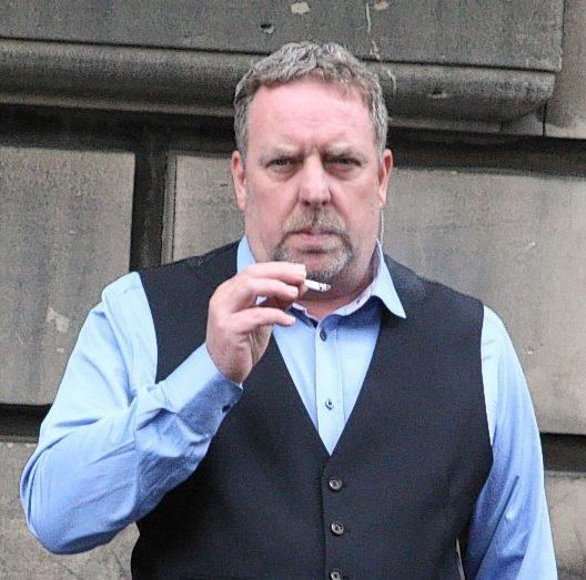 Mark Sainsbury outside court