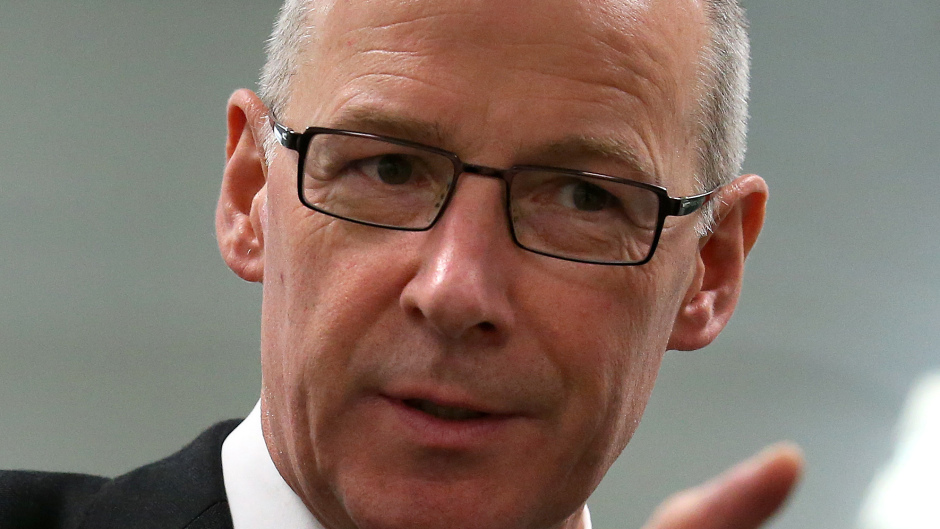 """John Swinney will stress it is in the """"national interest"""" for power to to be transferred to local communities"""