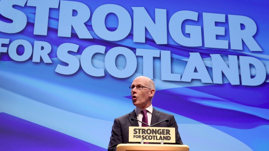 Deputy First Minister John Swinney delivers his speech at the SNP conference in Glasgow