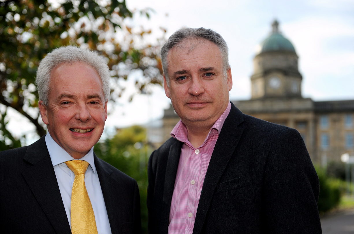 Malcolm Wright, chief executive NHS Grampian, left, with MSP Richard Lochhead, right, beside Dr Gray's Hospital, Elgin, following the talks.  Picture by Gordon Lennox