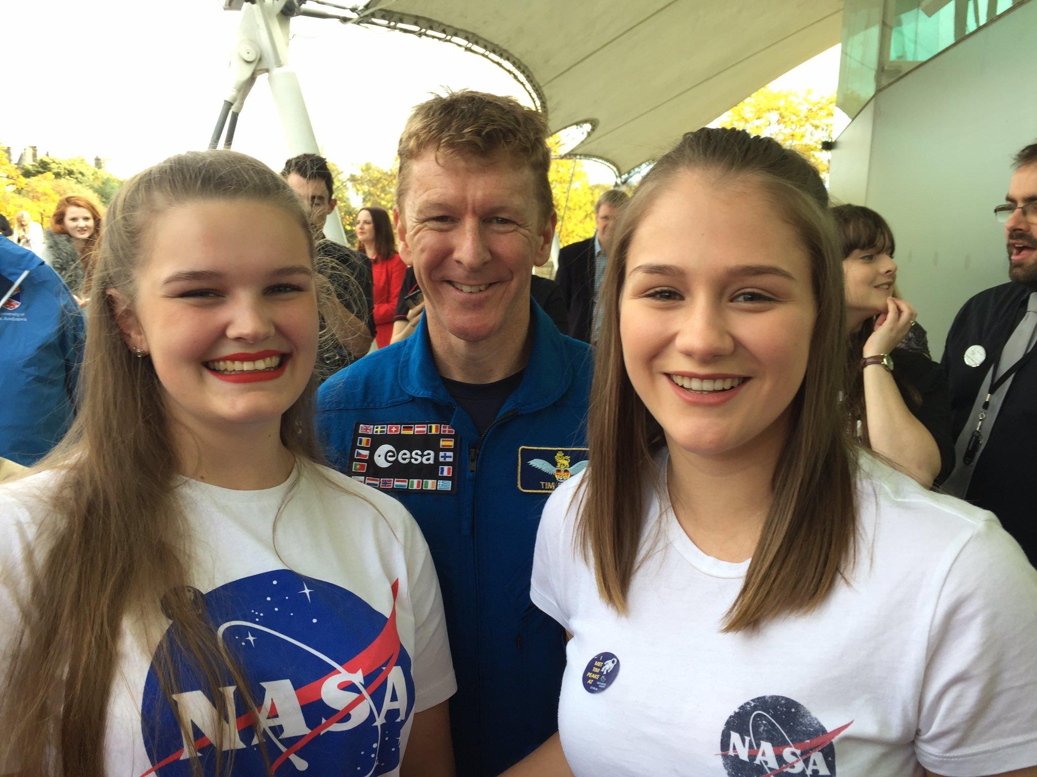 Elgin High School pupils Kirtsen Flett, left, and Ellen O'Hare, right, meet astronaut Tim Peake in Edinburgh.