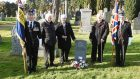 Relatives pay their respects to a WWI hero at a ceremony at Nairn Cemetery.