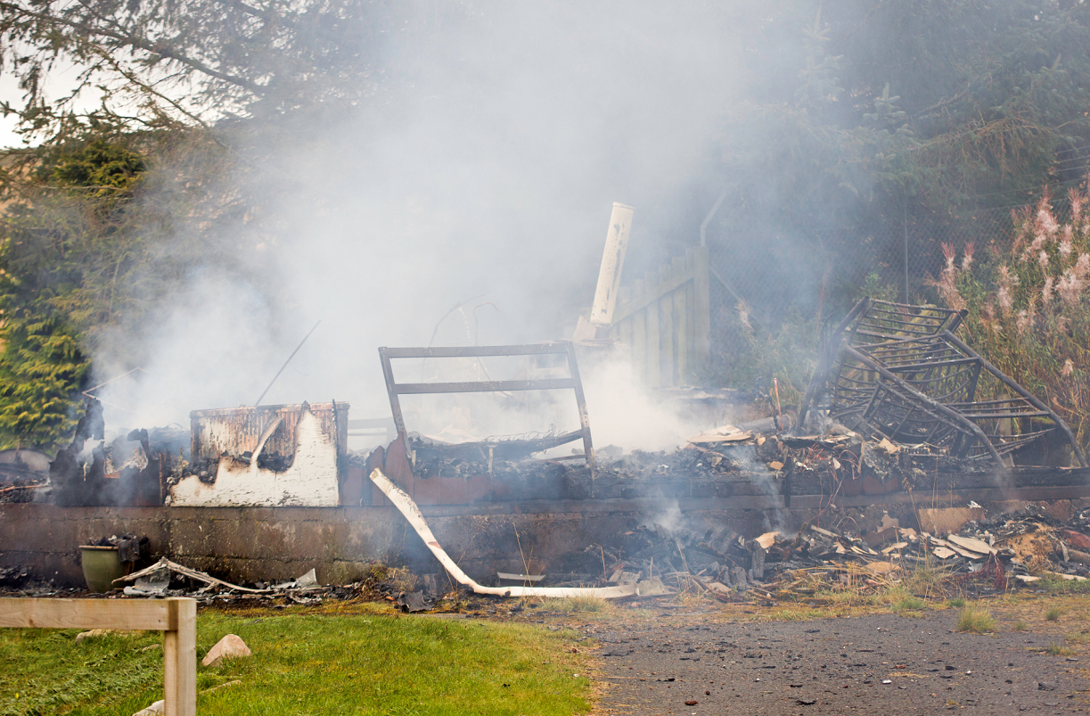 The chalet was burned to the ground in the fire.