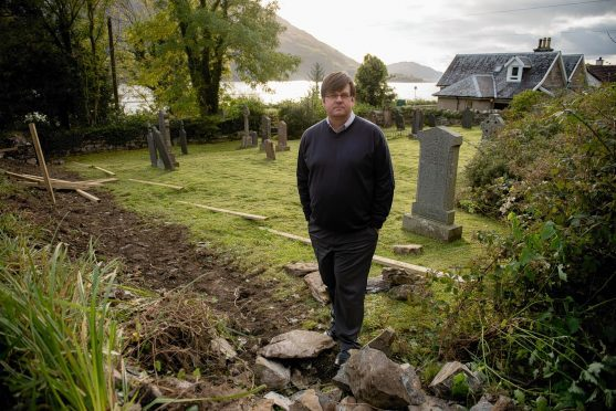 Councillor Andrew Baxter at the cemetery in Onich.