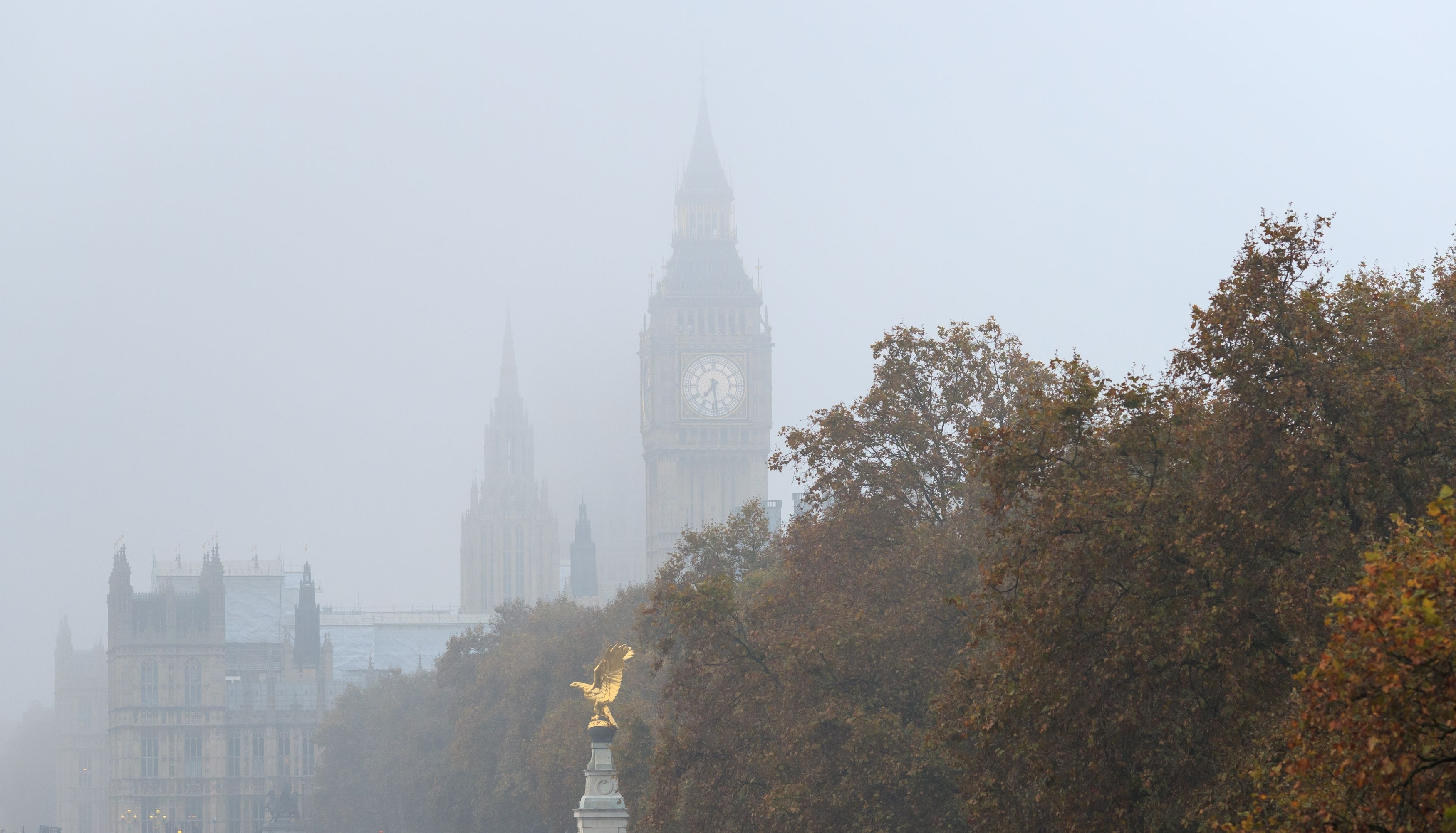 Big Ben in London, is seen through thick fog.