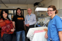 Gill and Andy Cowe, left, from Rockin' For Tots, being shown the equipment their donation will augment by consultant paediatrician, Dr Slawomir Wojcik, and Suzanne Wightman, who works in the maternity unit, at the maternity unit at Dr Gray's Hospital, Elgin.