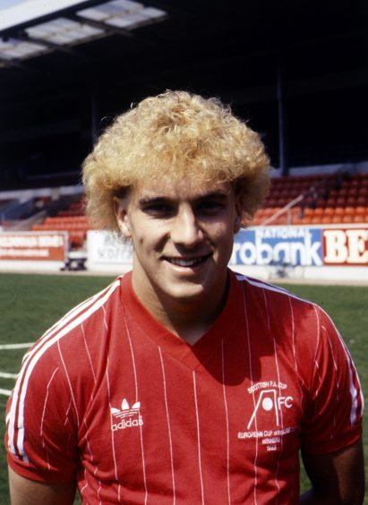 The hair makes it easy to sort out the decade for Neale Cooper.