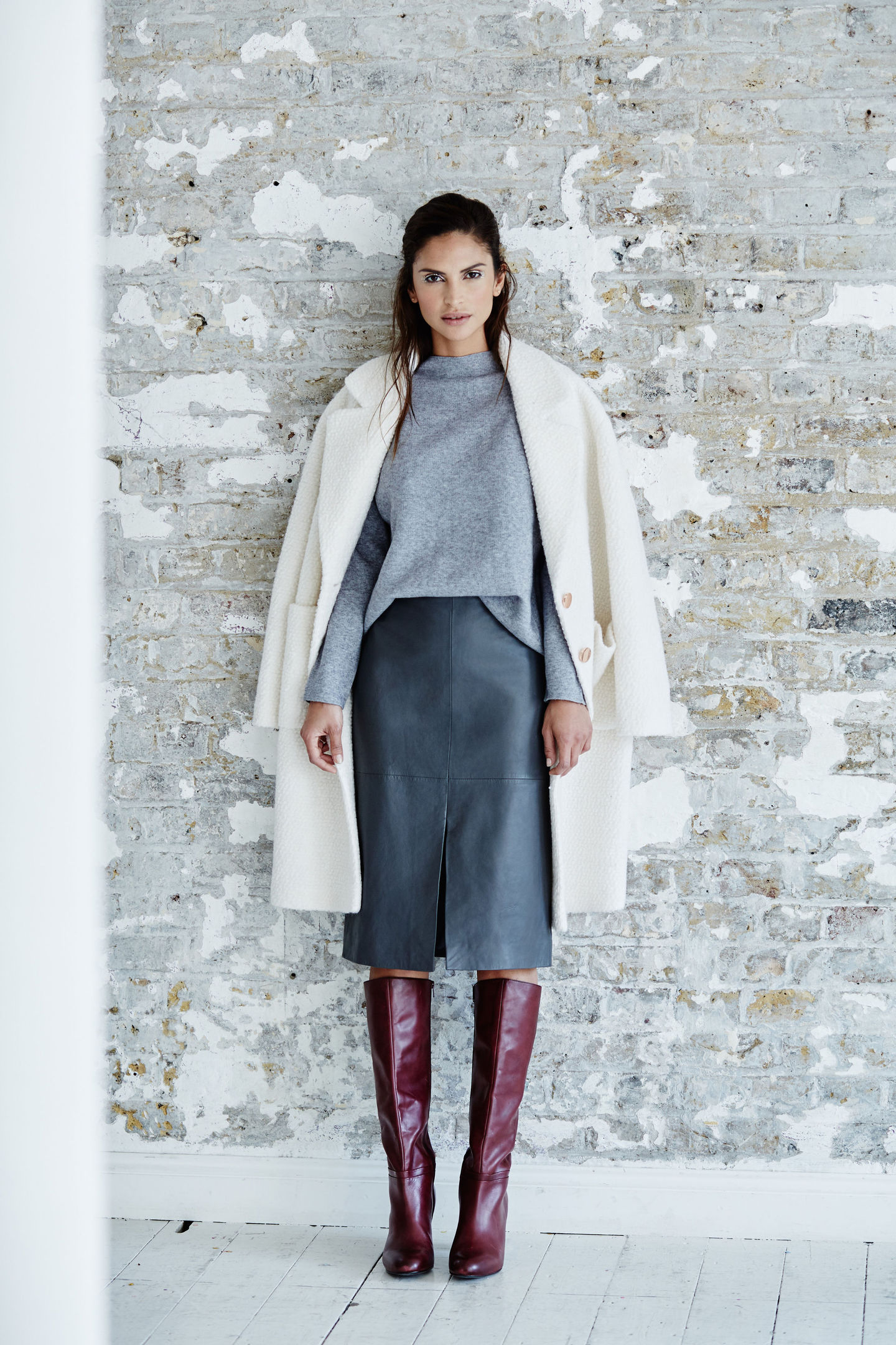 Tu Premium Textured Boucle Crombie Coat, Premium Twinset Knit, Premium Leather Pencil Skirt, Premium Long Leather Boots, all available from Sainsburys.