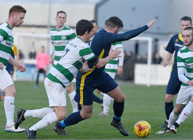 Daniel McLennan of Clach tries to keep the ball from Jay Cheyne of Buckie